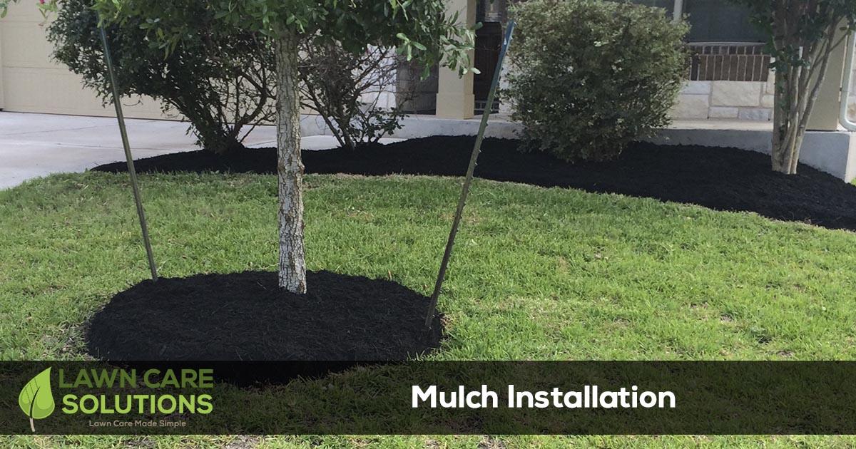 mulch installation on flower beds